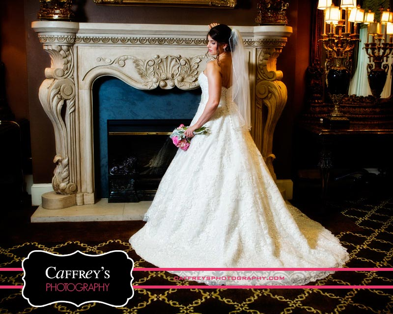 Stunning bride by the fireplace