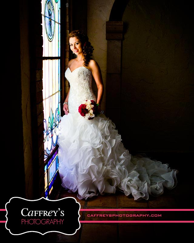 Breathtaking bride by stained glass at Las Velas